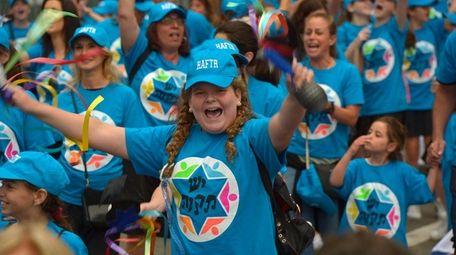 Celebrate Israel parade marchers seen along Fifth Avenue
