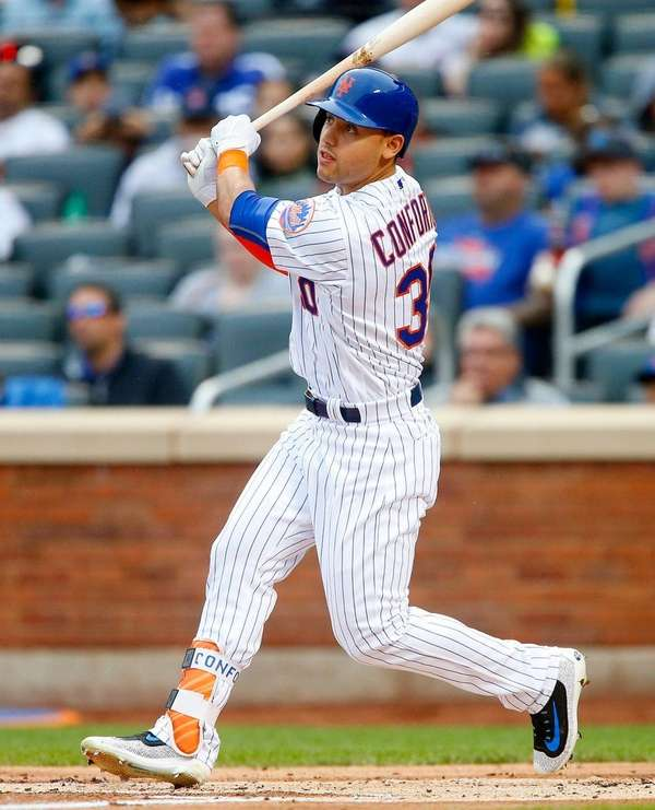Michael Conforto of the New York Mets follows