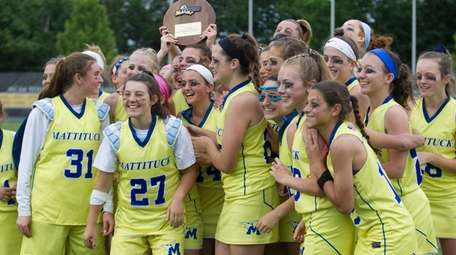 Mattituck-Southold players celebrate victory over Carle Place in