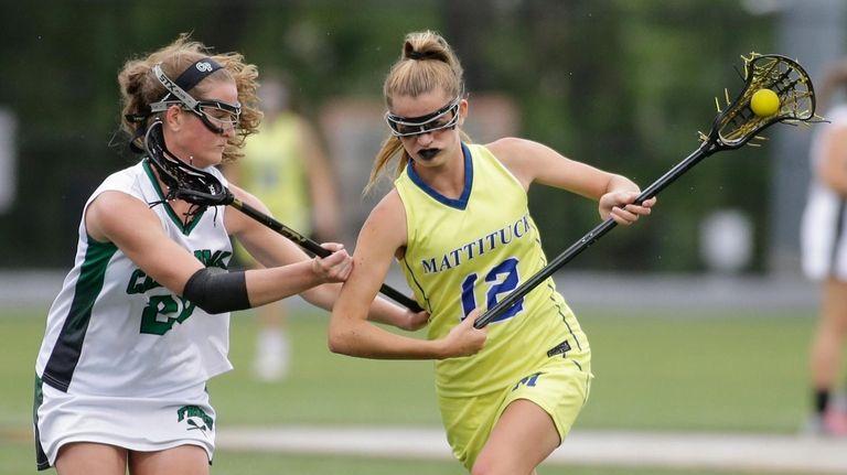 Mattituck-Southold's Mackenzie Hoeg looks to slide past Carle