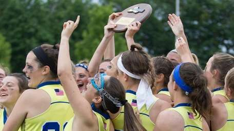The Mattituck/Southold girls lacrosse team celebrates its victory