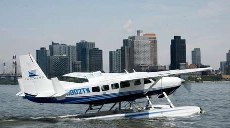 A Tailwind seaplane taxis in the East River