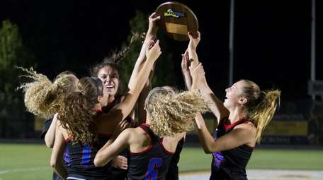 Middle Country girls lacrosse celebrates its victory over