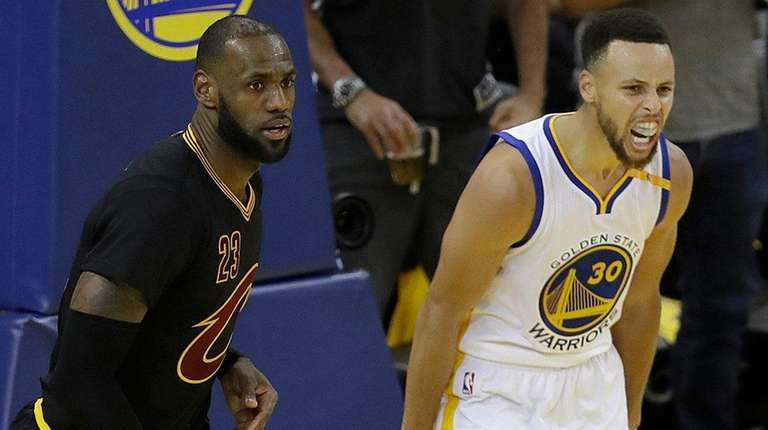 Warriors guard Stephen Curry reacts after scoring