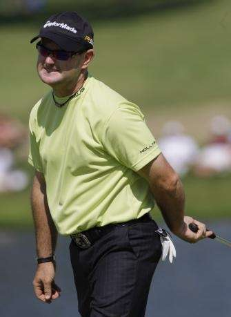 Rory Sabbatini, of South Africa, reacts after missing