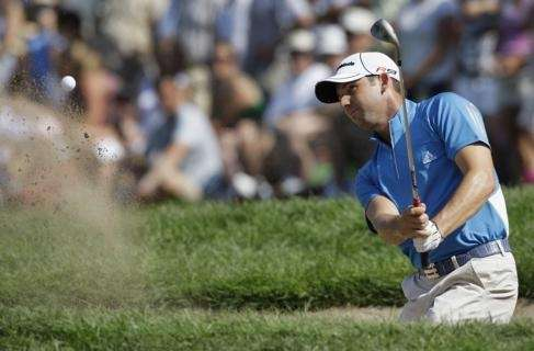 Sergio Garcia, of Spain, hits out of a
