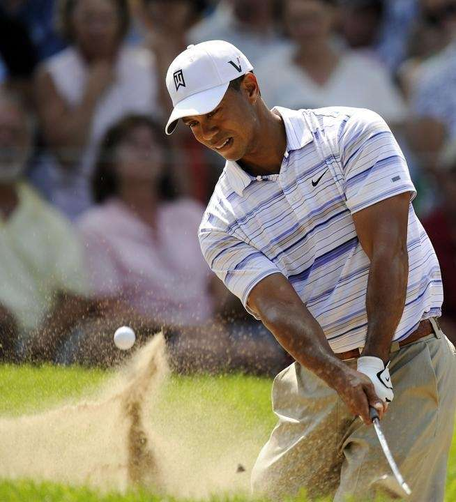Tiger Woods hits a shot during the 2nd