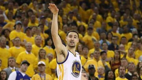 Klay Thompson of the Golden State Warriors watches