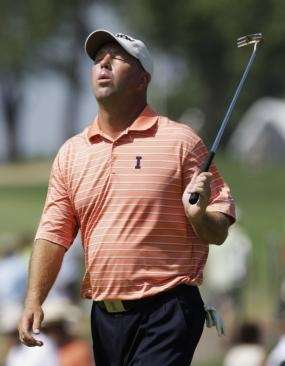 Mike Small reacts after a missed putt on