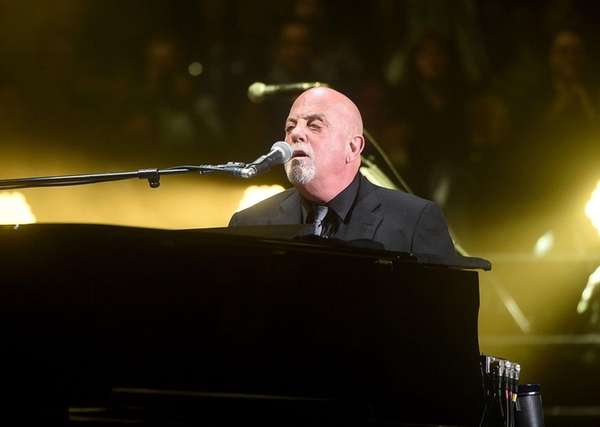 Billy Joel performs at a concert at Madison