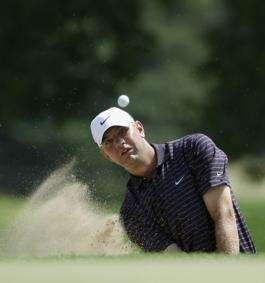 Lucas Glover watches his shot out of a