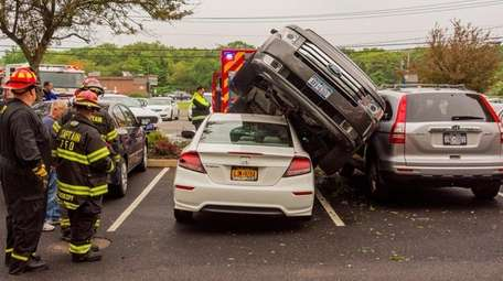 An out-of-control SUV crashed into two parked vehicles