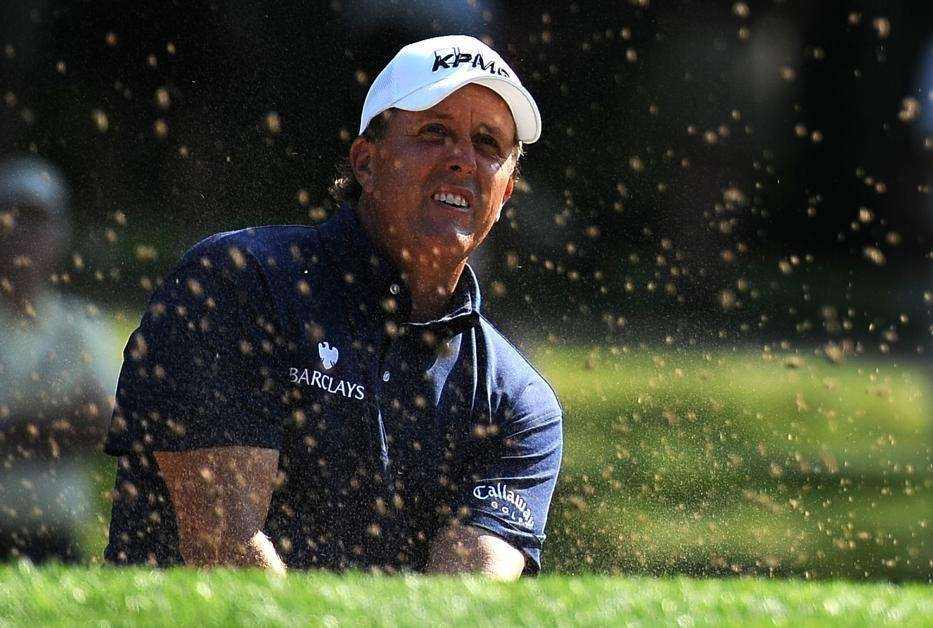 Phil Mickelson of the US shoots out of
