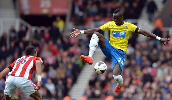 Newcastle United's Ivorian midfielder Cheick Tiote jumps for