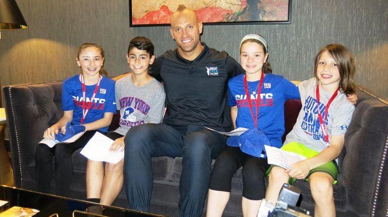 New York Giants player Mark Herzlich with Kidsday