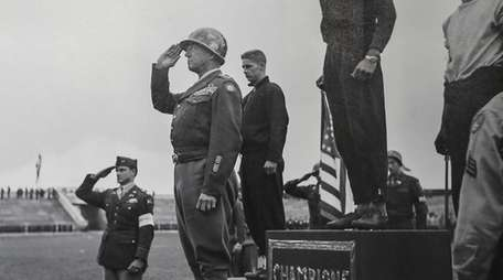 A photograph by Tony Vaccaro shows Gen. George