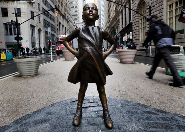 A sculpture titled 'The Fearless Girl' by artist