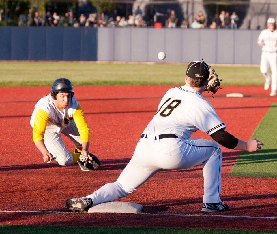 Massapequa's Mike Moreno tries to beat the throw