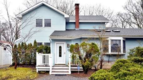 This five-bedroom Smithtown home, listed for $629,000, is
