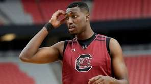 South Carolina's Sedee Keita warms up during a
