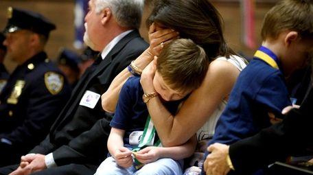 Lisa Tuozzolo embraces her son Austin on Tuesday,