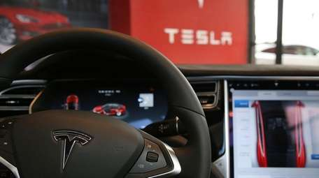 The inside of a Tesla vehicle in a