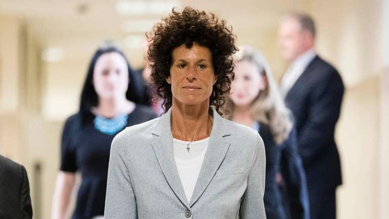Andrea Constand walks to the courtroom during Bill