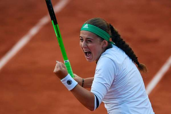 Latvia's Jelena Ostapenko reacts after winning her tennis