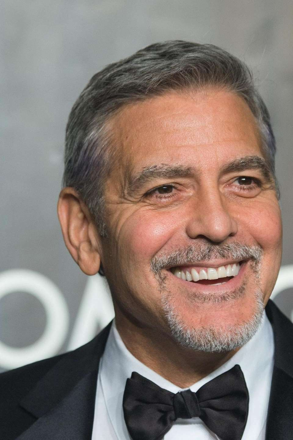George Clooney welcomed twins Ella and Alexander, with