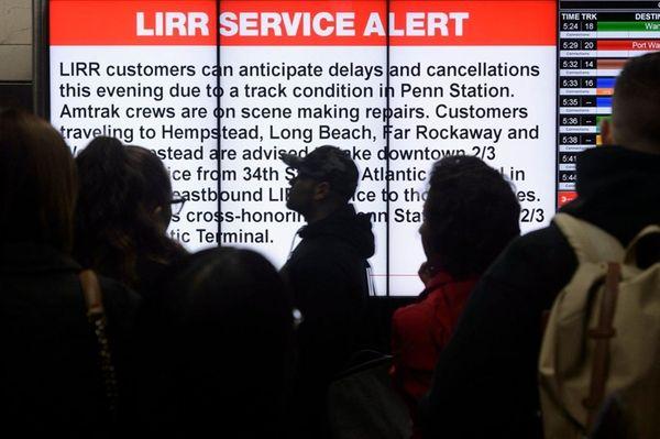 LIRR passengers at Penn Station walk past a