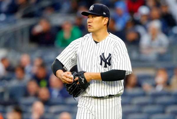 Masahiro Tanaka of the New York Yankees stands on