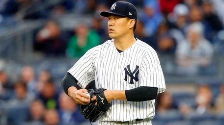 Masahiro Tanakaof the New York Yankees stands on