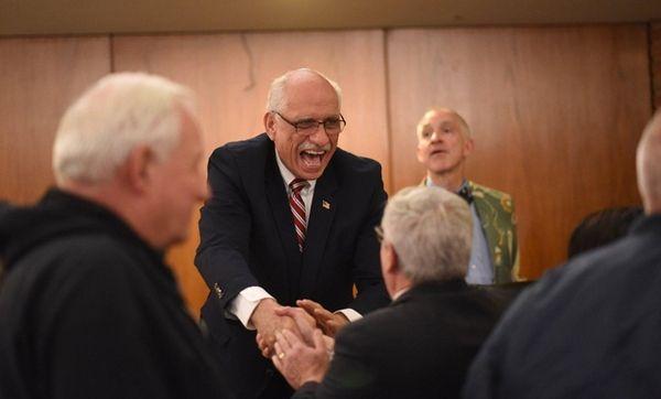 Former Nassau County Legislator Dennis Dunne is congratulated