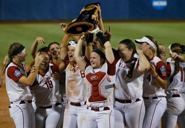 The Oklahoma team celebrates after defeating Florida in