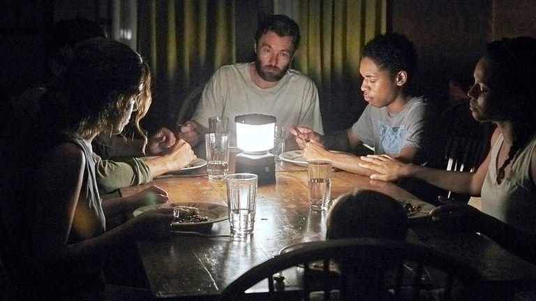 Kelvin Harrison Jr., center, Carmen Ejogo and Griffin