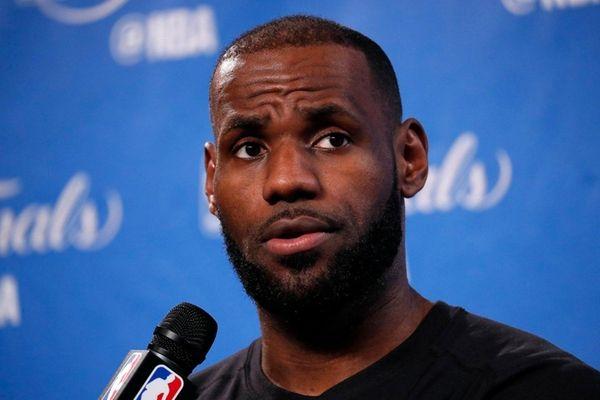 Cleveland Cavaliers forward LeBron James talks to media