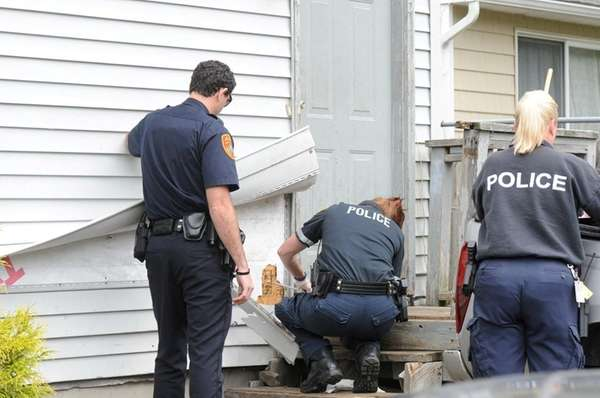 Suffolk County Police crime scene investigators probe bullet