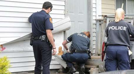Suffolk County Police crime scene investigators probe bullet