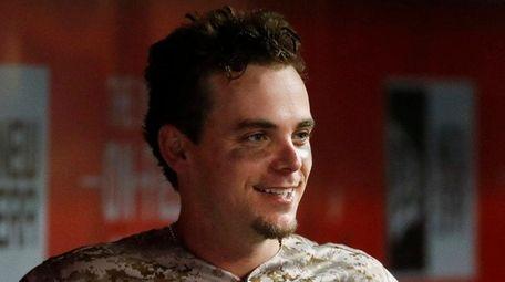 Cincinnati Reds' Scooter Gennett smiles in the dugout