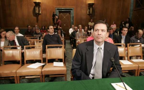 Then-former Deputy Attorney General James Comey waits to