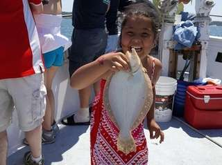 Emma Clontz, 8, holds the first fish she