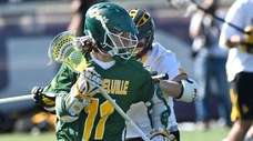Ward Melville's Matthew Grillo (11) moves the ball