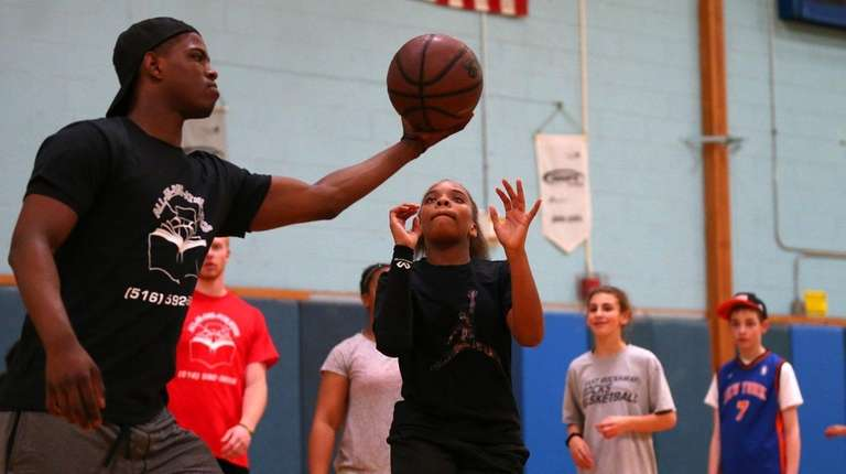 Isaiah Whitehead of the Nets gives a ball