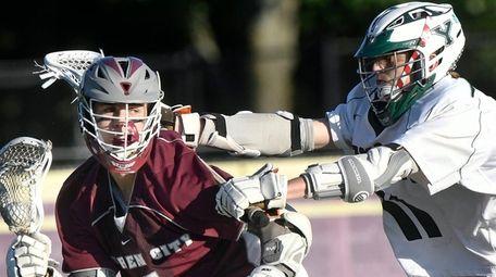 Garden City's Luke Keating moves the ball against
