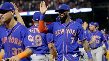 New York Mets' Michael Conforto and Jose Reyes