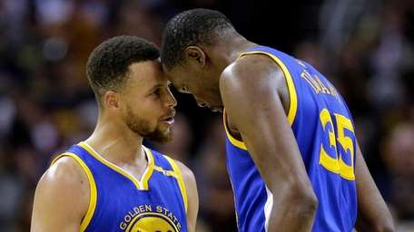 Golden State Warriors' Stephen Curry, left, and Kevin