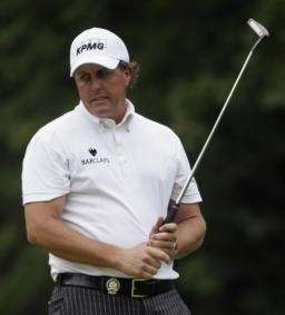 Phil Mickelson reacts after missing a putt on