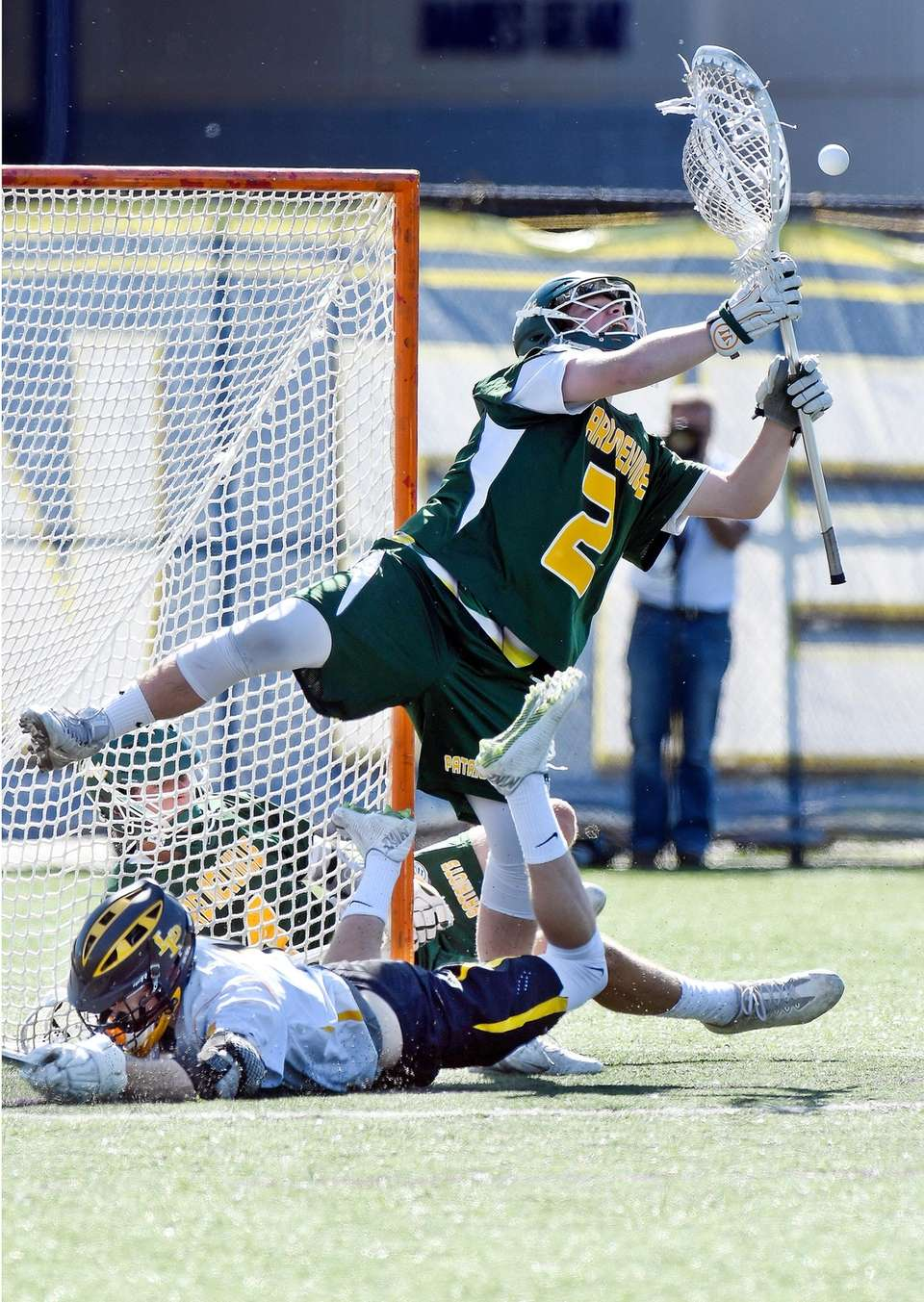 Ward Melville goalkeeper Perry Cassidy (2) defends against