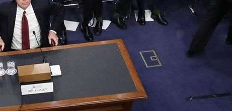 Former FBI director James Comey takes his seat
