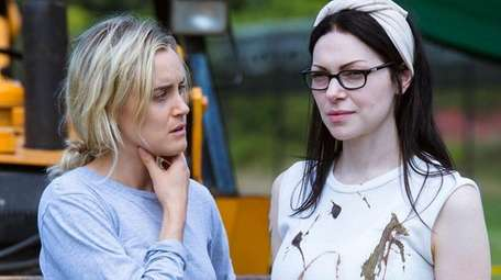 Taylor Schilling, left, and Laura Prepon star in
